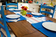 Dining Room Table. A dining room table with blue chairs, matching place mats Stock Photos