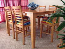 Dining Room Table. Shot of a wood dining room table with chairs stock image