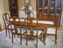 Dining room table and chairs. Luxury wooden dining room table and chairs Stock Photography