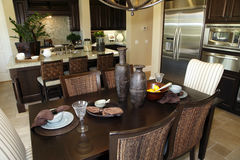 Dining room table with kitchen Stock Image