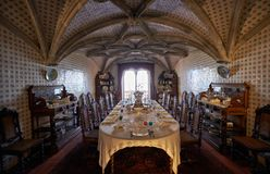 The dining room with the table served for the guests arrival. Pe Royalty Free Stock Images