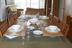 Dining room with table setting. Stylish dining room.Table setting for four people at home. Bowls on table are empty Stock Photos