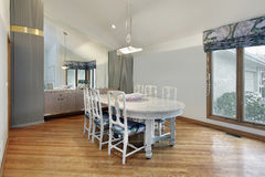 Dining room with tall ceiling Stock Photos