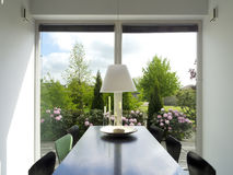 Dining room with view to the garden. Modern dining room with view to the garden Royalty Free Stock Photography
