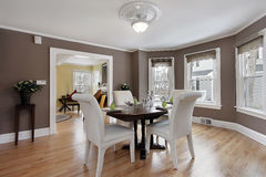 Dining room with wall of windows Stock Images