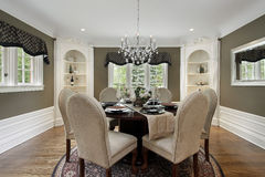 Dining room with white cabinetry Royalty Free Stock Images