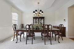 Dining room with white carpeting. Traditional formal dining room with white carpeting Royalty Free Stock Image
