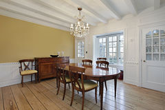 Dining room with white ceiling wood beams Royalty Free Stock Image