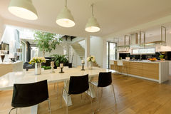 Dining room with white table and black chairs Stock Photos