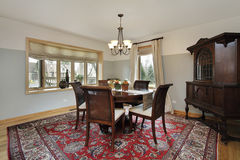 Dining room with wood trim windows Stock Photography
