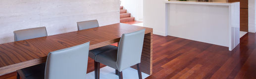 Dining room with wooden table stock image