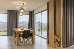 Dining room with wooden table Stock Photos