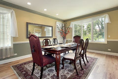 Dining room with yellow and green walls Stock Photos