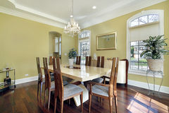 Dining room with yellow walls Stock Photography