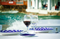 Dining by the sea. A table ready for a meal by the sea in Little Venice, Mykonos, Greece Stock Images