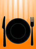 Dining set. The plate knife and fork Royalty Free Stock Image