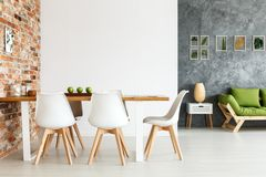 Dining space against brick wall
