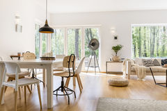 Dining space in lounge. Dining space with wooden table in cozy modern lounge royalty free stock images