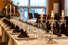 Dining with style. Candlelight dinner table set for a celebratory evening Royalty Free Stock Photo