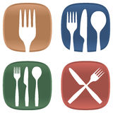 Dining symbols. A selection of dining symbols with cutlery and plates in several colours Royalty Free Stock Image