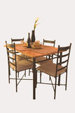 Dining table. A dining table set with wine and fruits ready for occupants Stock Photos