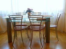 Dining table. Nice dining table with flower on it royalty free stock images
