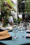 Dining table. Outdoor restaurant dining table with wine glass and tableware Royalty Free Stock Photos