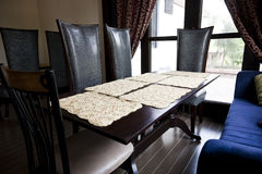 Dining table agaisnt a window Royalty Free Stock Photography