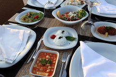 Dining table with assorted meze Royalty Free Stock Image