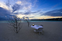 Dining table on the beach royalty free stock photo