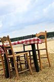 Dining table in a beach Royalty Free Stock Photos