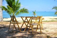 Dining table on the beach Stock Photography