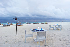 Dining table on the beach in maldives resort Stock Photography