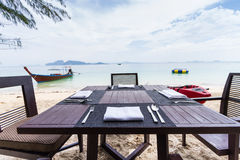 Dining table on the beach Stock Image