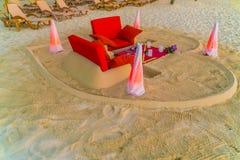 Dining table on beach at tropical Maldives island Stock Photos