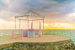Dining table on beach at tropical Maldives island Royalty Free Stock Photography