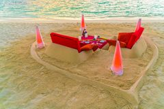 Dining table on beach at tropical Maldives island Royalty Free Stock Images