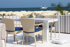 Dining table and chairs on the beach Royalty Free Stock Photo
