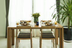 Dining table and chairs in modern home with elegant Stock Photo