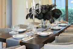 Dining table and chairs in modern home with elegant setting Stock Photography