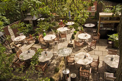 Dining table with chairs and parasol. Cafe terrace in York, European city,England. Stock Images
