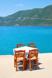 Dining table with chairs by the sea Stock Photography
