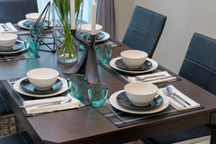 Dining table and comfortable chairs in modern home Stock Photo