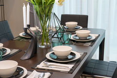 Dining table and comfortable chairs in modern home Royalty Free Stock Photo