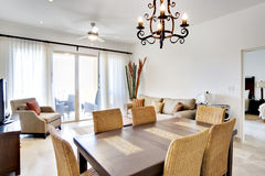 Dining Table in Condominium. View over dining room table Royalty Free Stock Photography