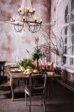 Dining table decorated for Christmas and evergreen centerpiece Royalty Free Stock Images