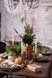 Dining table decorated for Christmas and evergreen centerpiece Stock Image
