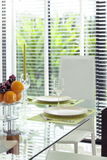Dining Table with dinner set with garden view Royalty Free Stock Photo