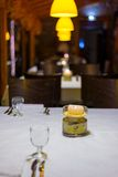 Dining table in elegant italian restaurant. Romantic dining table in elegant italian restaurant ready to be arranged for dinner. Selective focus on burning Stock Images