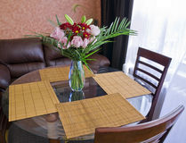 Dining table with flowers. Dining tables with flowers and chairs stock photos